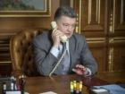 Порошенко обговорив з Путіним необхідність припинення вогню та зустріч у Мілані