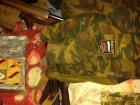 У екс-чиновника Харківщини вилучили зброю, військову форму з шевронами ЗС РФ
