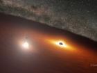 Телескоп Спітцера показав точний момент в танці чорних дір