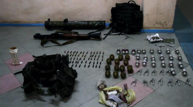 схованка з російською зброєю та спорядженням на фото 1