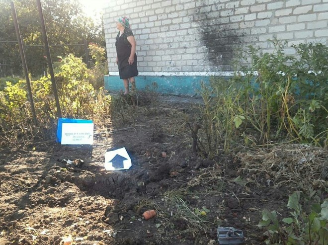 последствия обстрела жилого квартала Новолуганска на фото 2