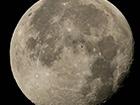 NASA показала фото МКС на фоне полной Луны