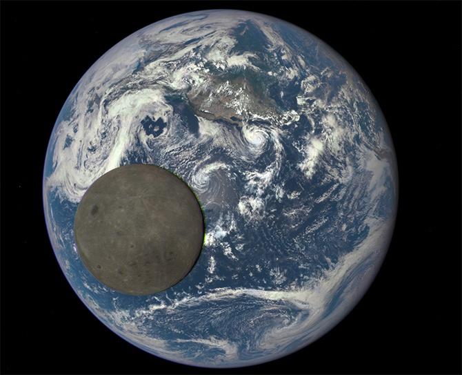NASA показала «темную сторону» Луны на фоне Земли - фото