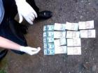 На Буковине подполковник полиции вымогал у подчиненного 500 долларов и 500 евро