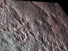 Участок поверхности Плутона, напоминающую змеиную кожу, показала НАСА